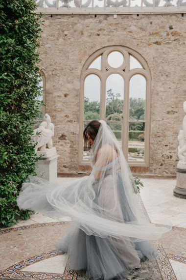 Bride in Custom Made Blue Claire La Faye Wedding Dress