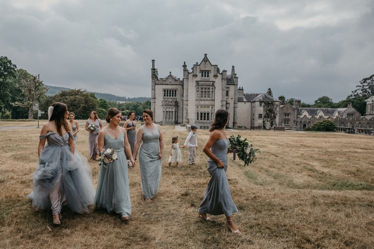 Bridal Party with Bride in Custom Made Blue Claire La Faye Wedding Dress and Bridesmaids in Different Grey Dresses