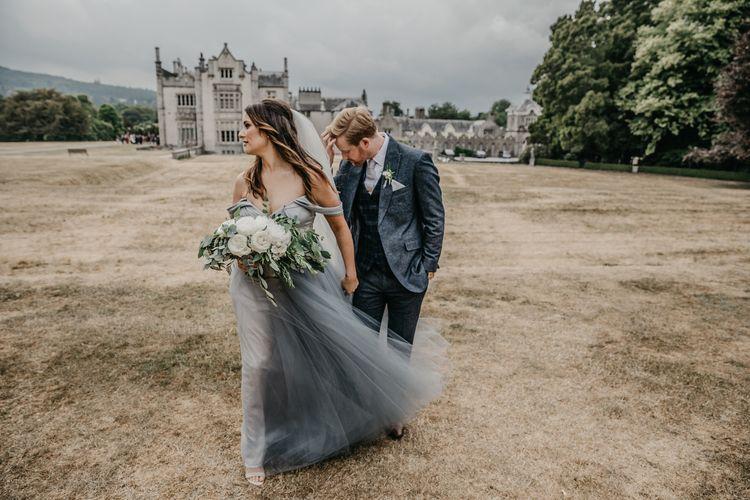 Bride in Custom Made Blue Claire La Faye Wedding Dress and Groom in Bespoke Alton Lane Wool Suit