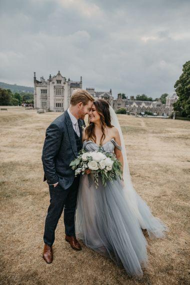 Bride in Custom Made Claire La Faye Wedding Dress and Groom in Bespoke Alton Lane Suit