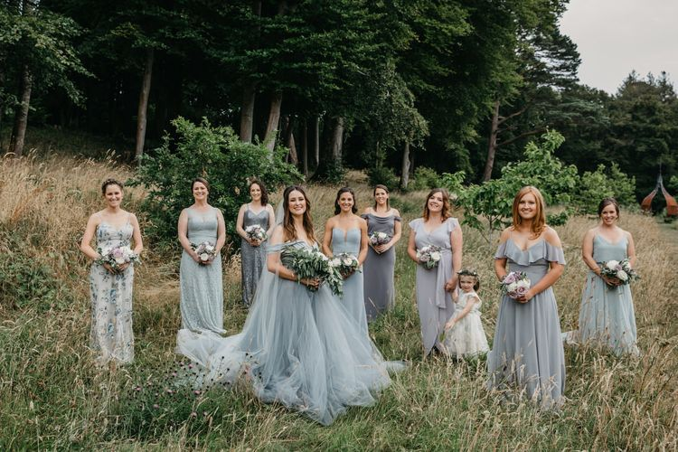 Bridal Party Portrait with Bride in Custom Made Blue Claire La Faye Wedding Dress and Bridesmaids in Different Dresses