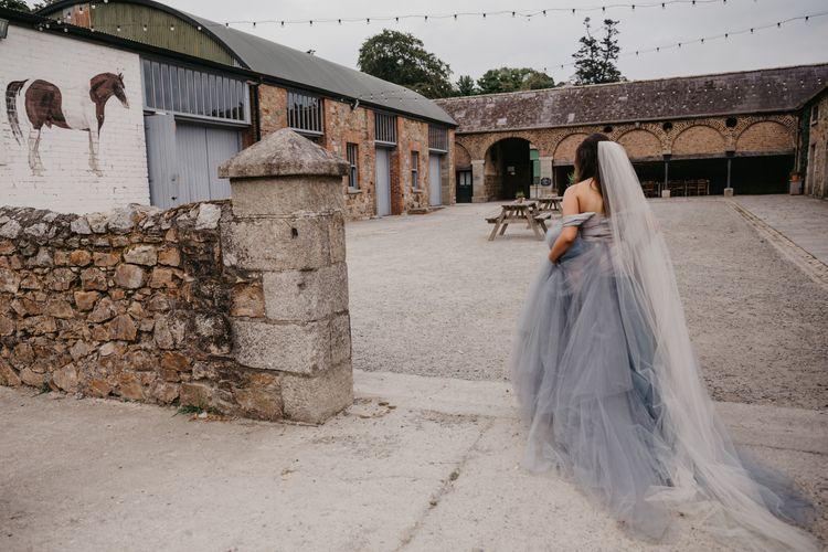 Bride in Custom Made Blue Claire La Faye Wedding Dress Walking to the Venue