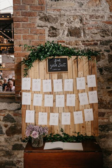 Wooden Table Plan with Strung Up Tables and Greenery Garland
