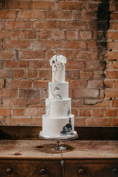 Four Tier Wedding Cake with Blue & Gold Geode Decor