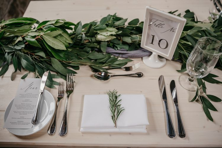 White and Green Table Decor with Greenery Garland