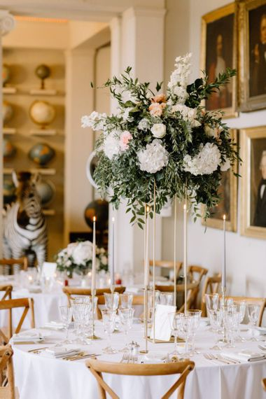 Tall wedding reception floral centrepiece