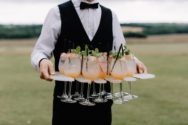 Wedding cocktails for luxury wedding at Aynhoe Park with Berta Bridal gown