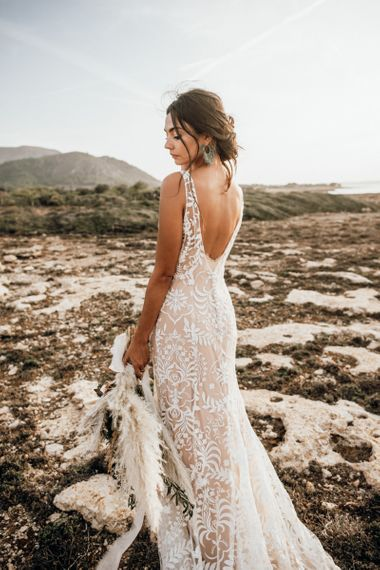 Boho bride in lace wedding dress for intimate Mallorca elopement