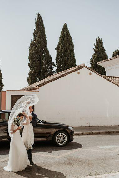 Bride in Sole Alonso Feather Trim Wedding Dress | Malaga Destination Wedding | Sara Lobla Photography | Un Par de Medias Film