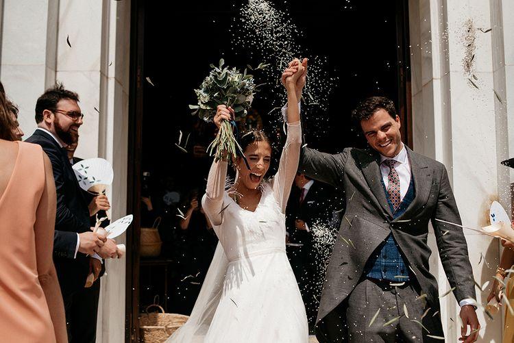 Confetti Moment | Bride in Sole Alonso Feather Trim Wedding Dress | Groom in Morning Suit | Malaga Destination Wedding | Sara Lobla Photography | Un Par de Medias Film
