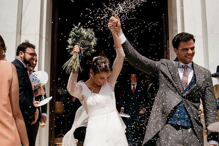 Confetti Exit | Bride in Sole Alonso Feather Trim Wedding Dress | Groom in Morning Suit | Malaga Destination Wedding | Sara Lobla Photography | Un Par de Medias Film