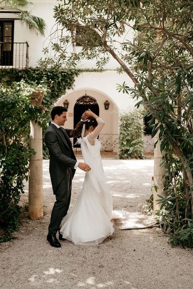 Bride in Sole Alonso Feather Trim Wedding Dress | Groom in Morning Suit | Malaga Destination Wedding | Sara Lobla Photography | Un Par de Medias Film