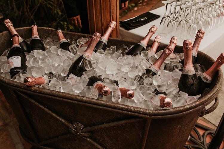 Champagne Trough Wedding Drinks | Malaga Destination Wedding | Sara Lobla Photography | Un Par de Medias Film
