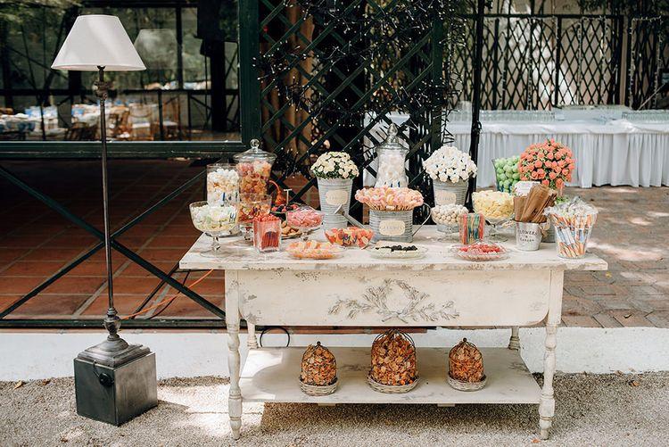 Sweets Table in Apothecary Jars | Malaga Destination Wedding | Sara Lobla Photography | Un Par de Medias Film