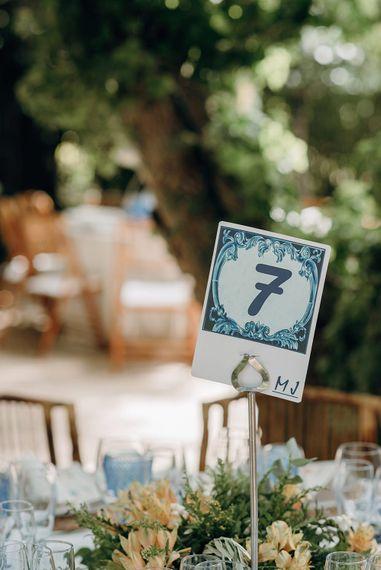 Blue Table Numbers On The Day Wedding Stationery Reception Decor | Malaga Destination Wedding | Sara Lobla Photography | Un Par de Medias Film