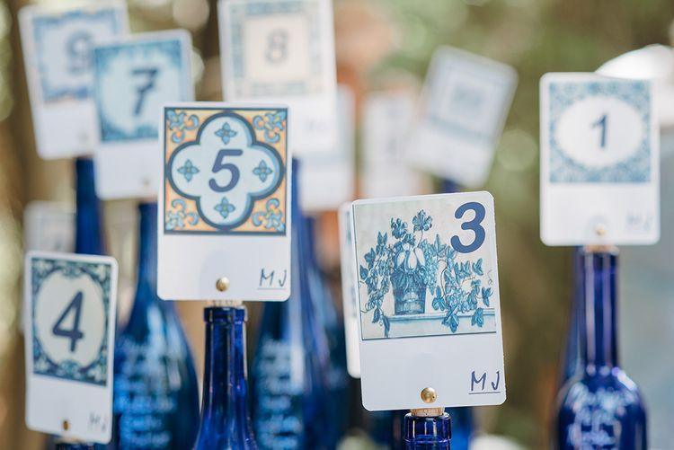 Blue Table Plan Signs On The Day Wedding Stationery Reception Decor | Malaga Destination Wedding | Sara Lobla Photography | Un Par de Medias Film