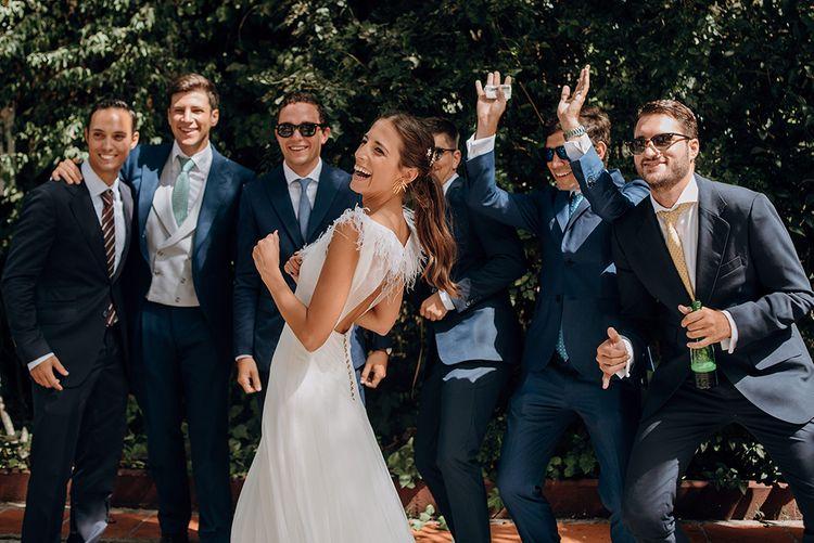 Bride in Sole Alonso Feather Trim Wedding Dress | Groomsmen in Navy Suits | Malaga Destination Wedding | Sara Lobla Photography | Un Par de Medias Film