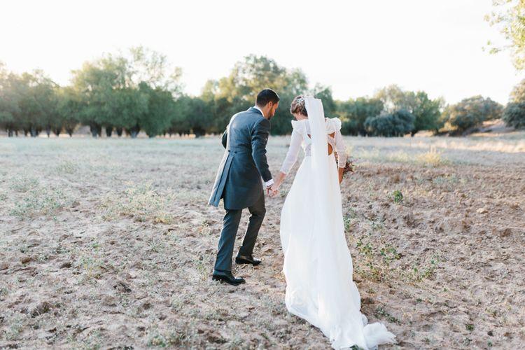 Stylish Wedding Dress with beautiful Back Detail from Beba's Closet, for a Destination Wedding at Castillo de Viñuelas in Madrid, Spain | Lorena San José Photography