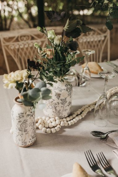 Wedding table decor with flowers and pearls styled by Paloma Cruz