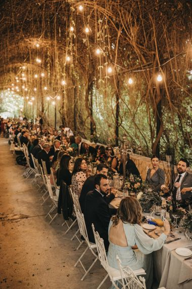 Flower tunnel with hanging lights for wedding breakfast