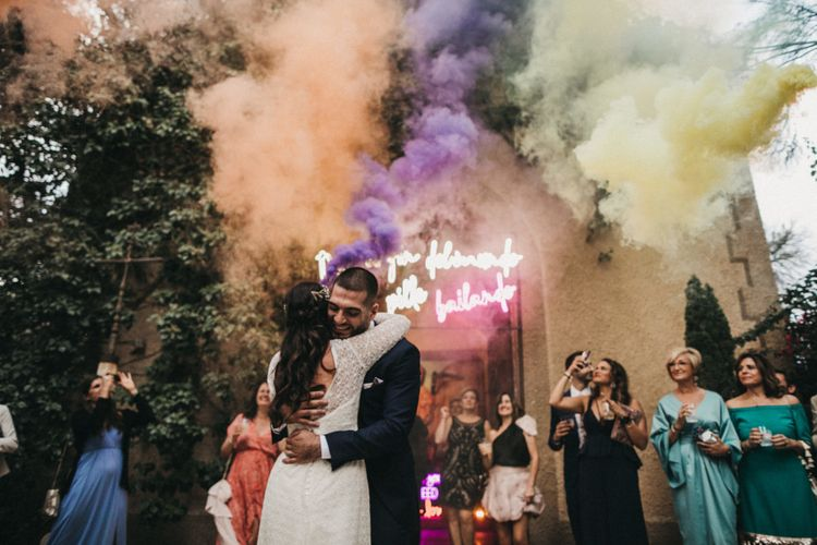 Coloured smoke flare at wedding