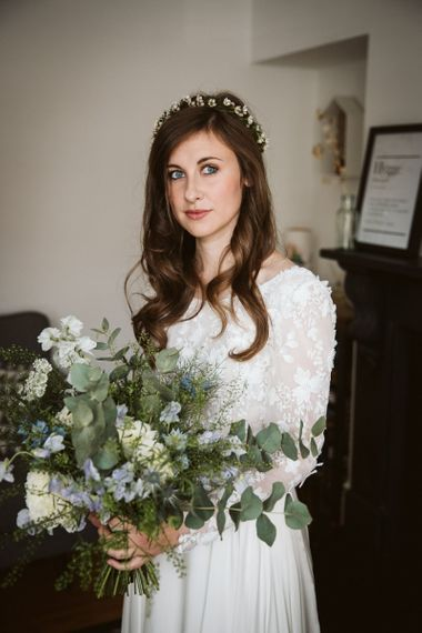 Beautiful Bride in Emma Beaumont Wedding Dress with Delicate Flower Crown and Wildflower Wedding Bouquet