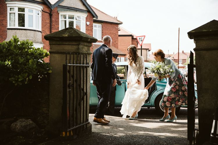 Bride Getting Out of the Car in an Emma Beaumont Wedding Dress and Blue Suede Shoes