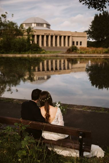 Bride and Groom Sitting on a Bench Looking at Wylam Brewery Wedding Venue in Newcastle