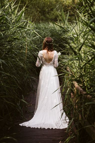 Bride in Low Back Emma Beaumont Wedding Dress with Applique Detail