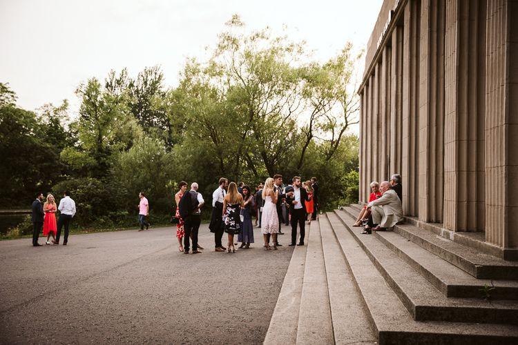 Wedding Guests Sitting on the Steps Outside Wylam Brewery Wedding Venue