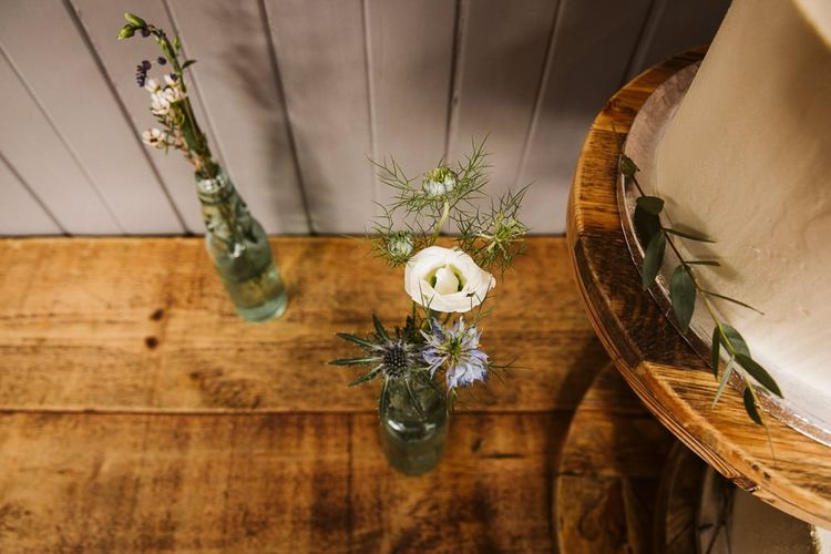Bottles Filled with Wildflower Stems