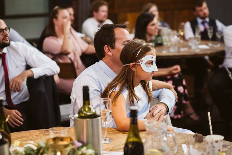 Wedding Guests Listing to the Speeches in Masks