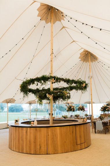 Foliage Hoop in Tent Wedding by PapKata Image by Lucy Davenport Photography
