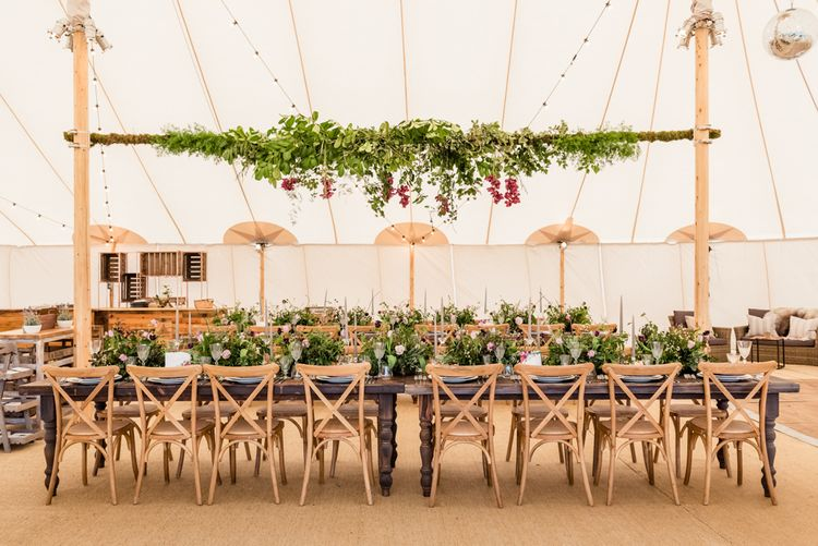 Hanging Foliage in Tent Wedding by PapKata Image by Lucy Davenport Photography
