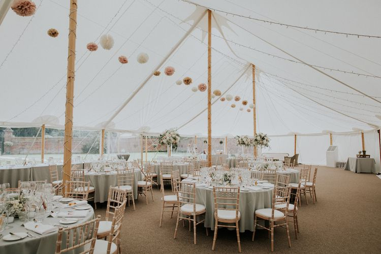 Hanging Neutral Pom Poms in Wedding Marquee at Dorfold Hall Image by Joasis Photography