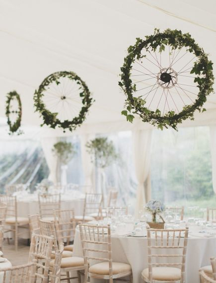Bike Wheels Hanging Decor in Marquee by Hatch Marquee Hire Image by Josh Gooding Photography