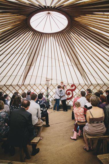 Yurt Wedding Ceremony Kiss by Helen Lisk Photography