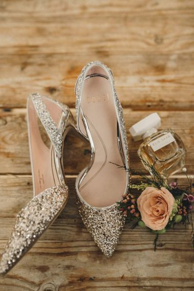 Silver glitter wedding shoes and perfume