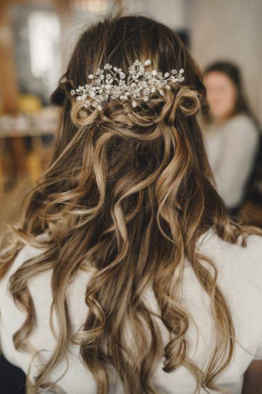 Half up, half down wedding hair with jewelled hair slide