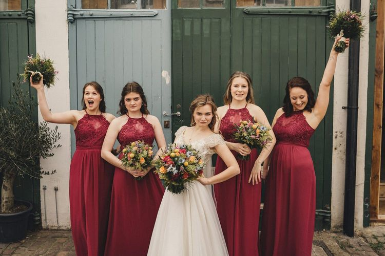 Bridal party portrait with bridesmaids in red lips dresses