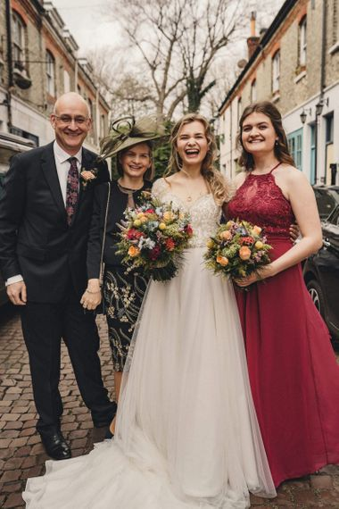 Bride portrait with her family