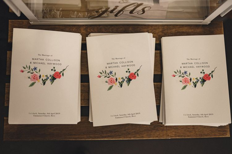 wedding order of service books with floral illustration