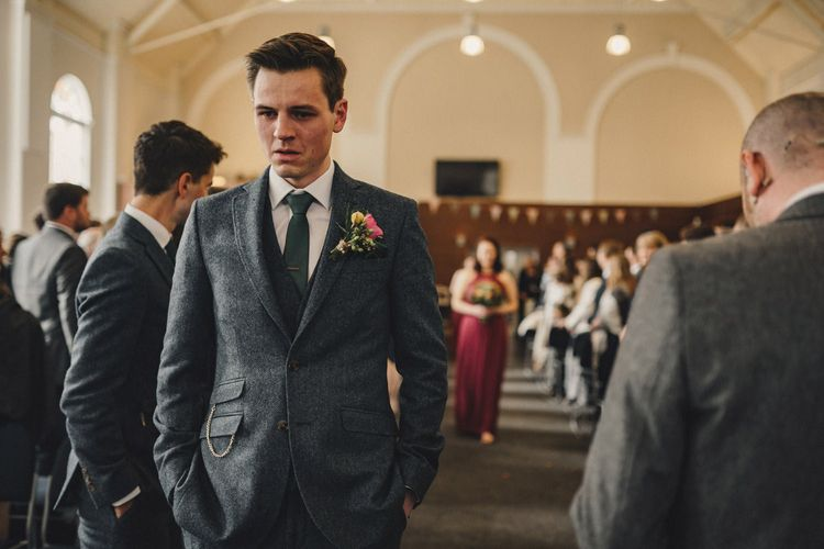 Groom in wool suit waiting at the altar