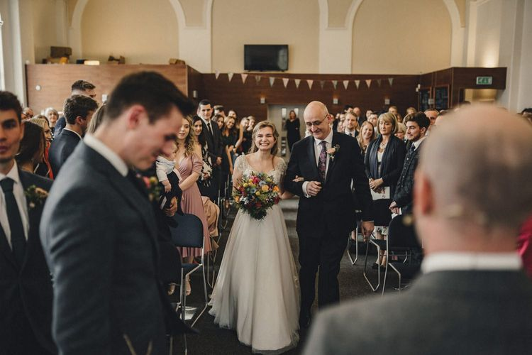Wedding ceremony bridal entrance in customised Morilee wedding dress