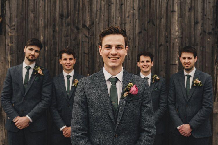 groomsmen in blue wool suits