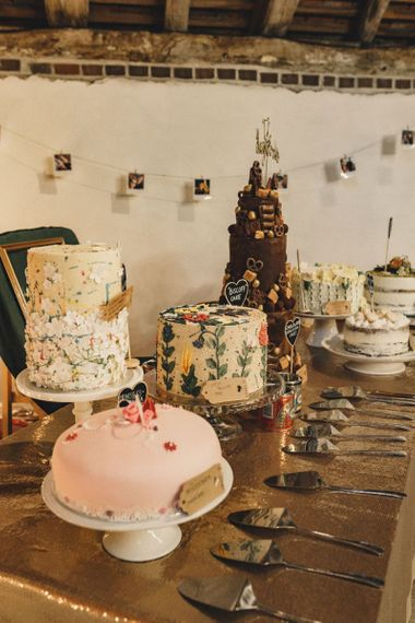 Dessert table at the rustic barn wedding on former 2014 Great British Bake Off contestant Martha Collinson