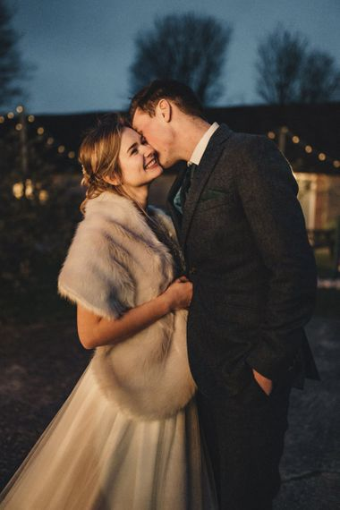 former 2014 Great British Bake Off contestant Martha Collinson in faux fur coverup at her wedding