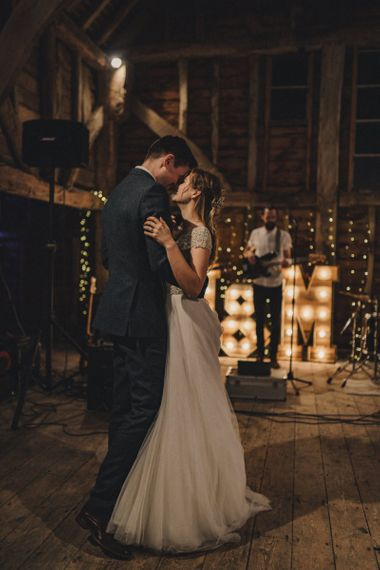 First dance with giant light up letters in the background