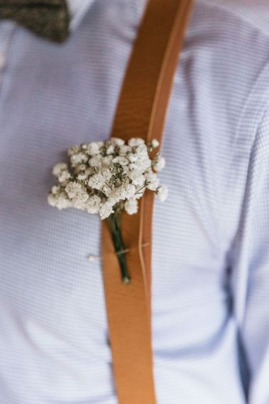 Floral buttonhole for groom with braces