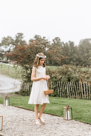 Flower girl with flower crown and petal basket